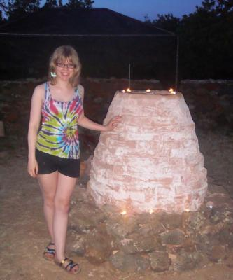 Figure 2. Author standing next to pottery kiln (Photo credit: Author)