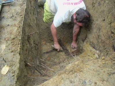 Figure 1 - Author discovering wooden trench boarding, Ypres 2010 (Image Copyright - Alex Sotheran)