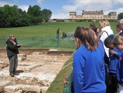 Figure 1: Author giving a site tour to a group of local schoolchildren (Image Copyright: Emily Rayner)