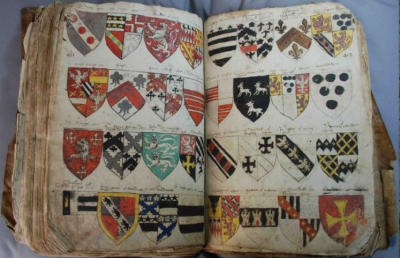 Figure 1: A heraldic manuscript from the YAS archives on display at Leeds City Museum  (Image Copyright: Yorkshire Archaeological Society)