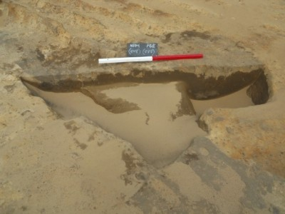 Figure 4. Wind-blown sand rapidly filling an excavated feature (image copyright by author).