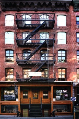 Figure 1: The exterior of the Lower East Side Tenement Museum.  The building was constructed using cheap materials and many apartments had no running water.<br /> (Image: Fletcher6, Creative Commons, 2012).